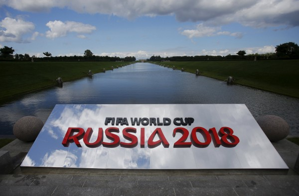 The 2018 World Cup logo is pictured near the Konstantin (Konstantinovsky) Palace, the venue of the preliminary draw for the 2018 World Cup, in St. Petersburg, July 24, 2015. The 2018 World Cup's preliminary draw will be held in St. Petersburg on July 25. REUTERS/Maxim Shemetov