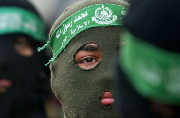 Description=Palestinian militants from Hamas wear masks during the funeral of female suicide bomber Reem Raiyshi, 22, in Gaza City, Thursday, Jan. 15, 2004. Raiyshi blew herself up Wednesday at the major crossing point between Israel and the Gaza Strip, killing four Israelis and wounding seven other people. (AP Photo/Kevin Frayer)