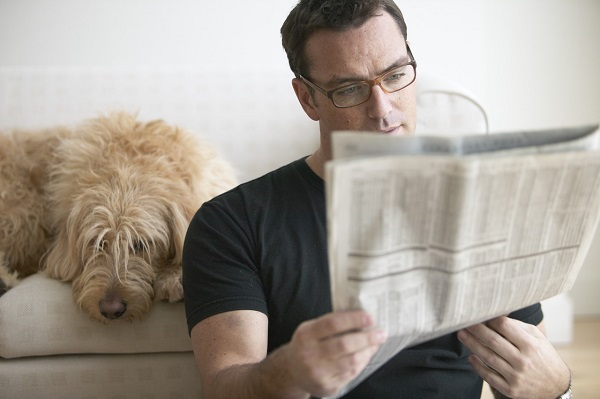 Man reading newspaper --- Image by © LWA-Sharie Kennedy/Corbis